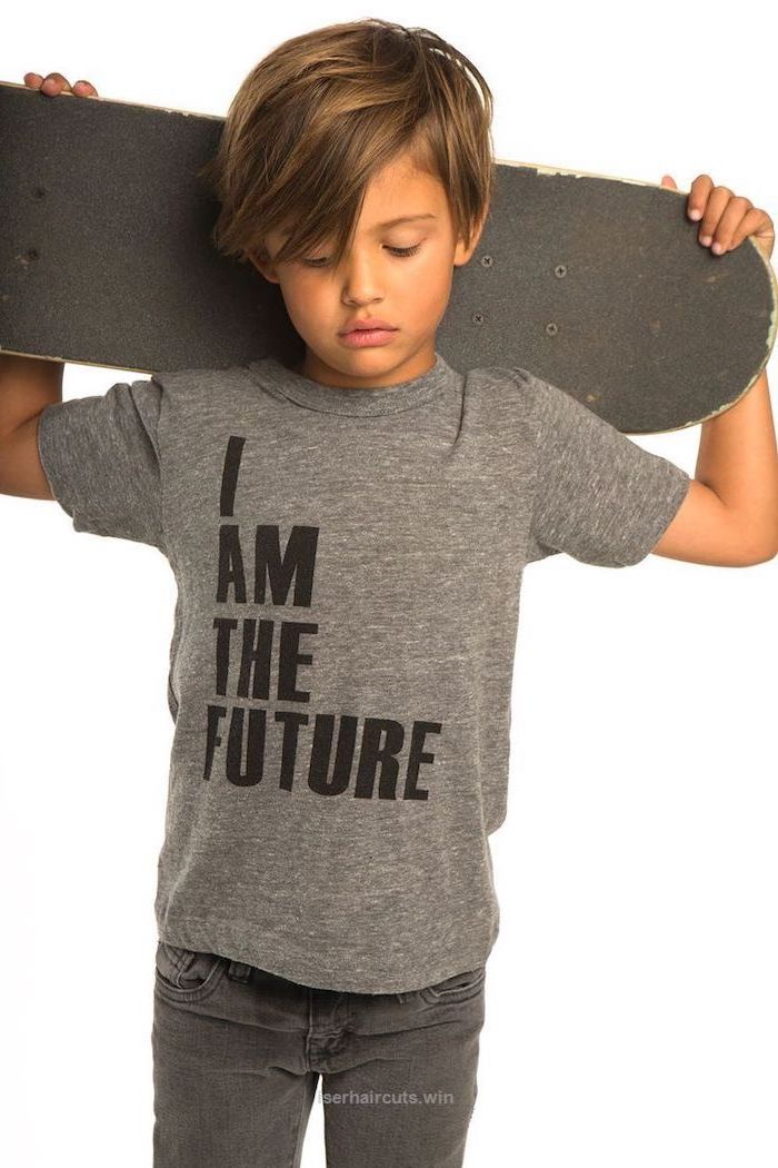 little boy, carrying a skateboard, i am the future t shirt, boys haircuts, blonde hair, dark jeans