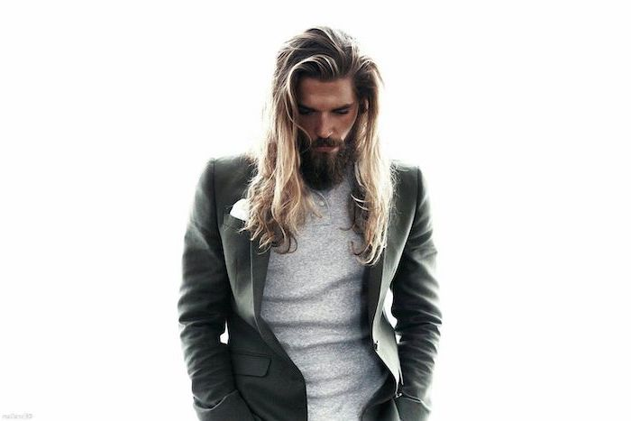 blonde wavy hair, hairstyles for men, grey blazer, grey blouse, white background