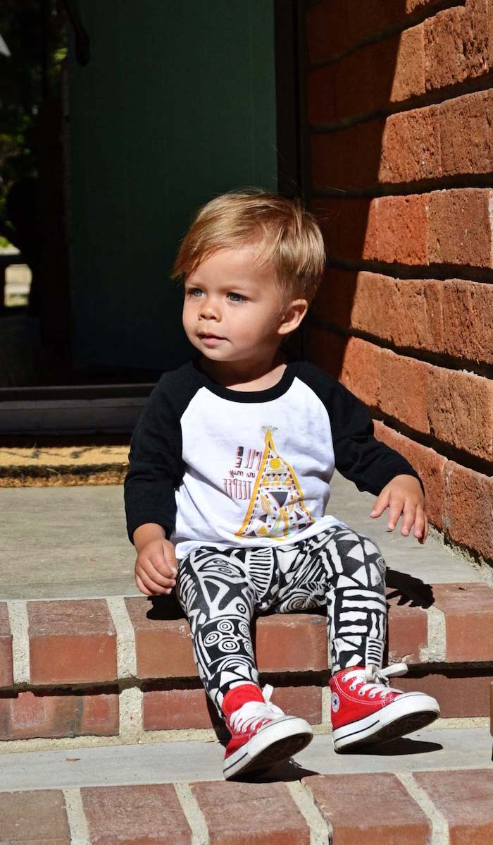 little boy haircuts, toddler boy, sitting on a step, black and white outfit, red converse shoes, brick wall