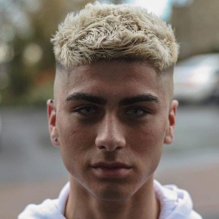 blonde hair, blue eyes, cute boy haircuts, white sweatshirt, small earring