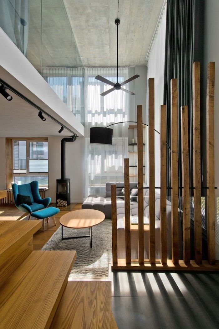 wooden sticks, room divider ideas, blue armchair, grey corner sofa, wooden staircase, white rug
