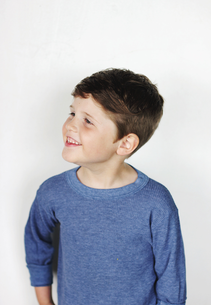 white background, cute boy haircuts, blue blouse, brown hair, little boy