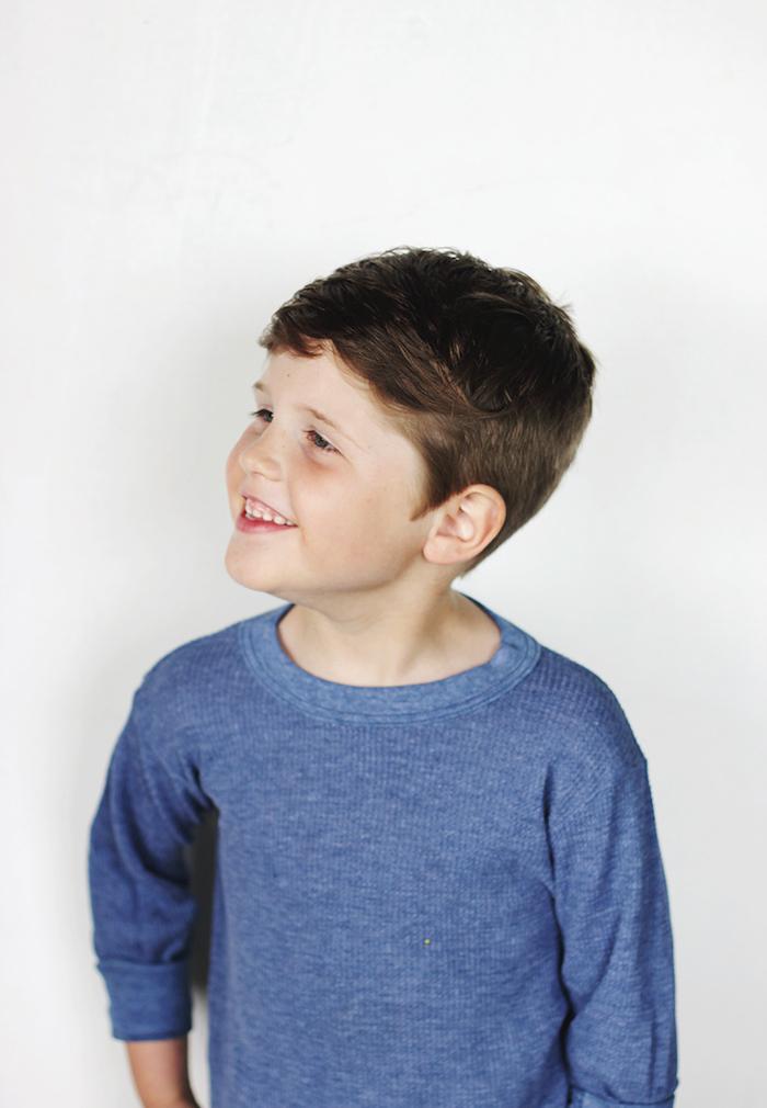 white background, cute boy haircuts, blue blouse, brown hair, little boy