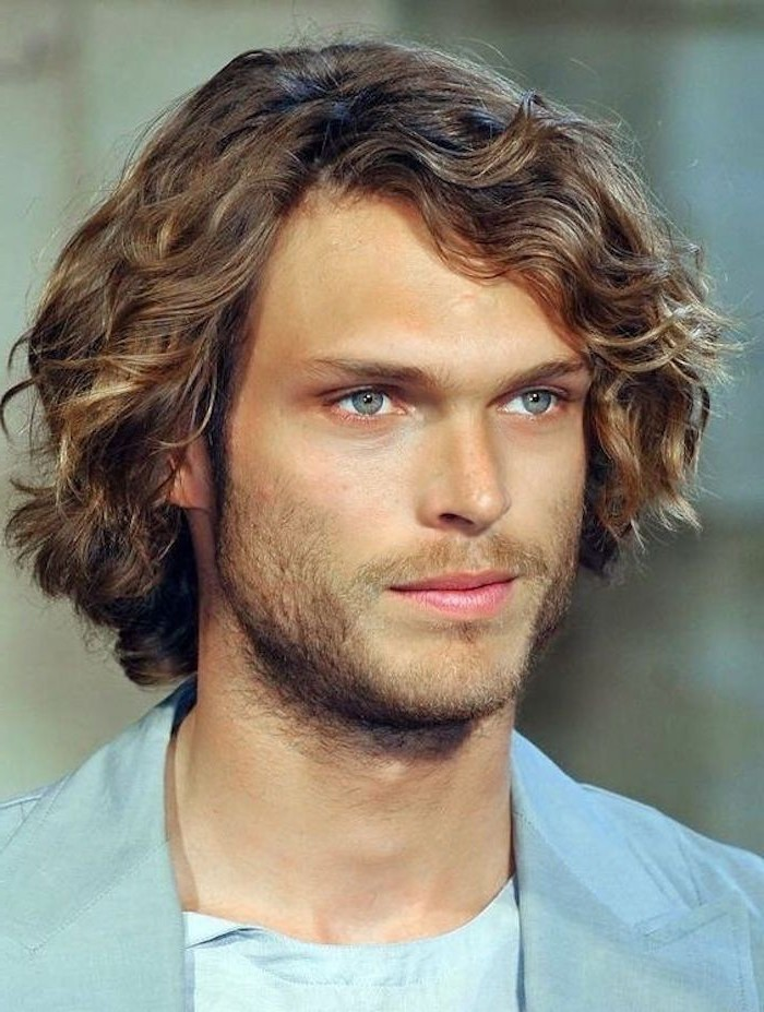 dark blonde, curly hair, hair styles for men, blue blazer, blue eyes