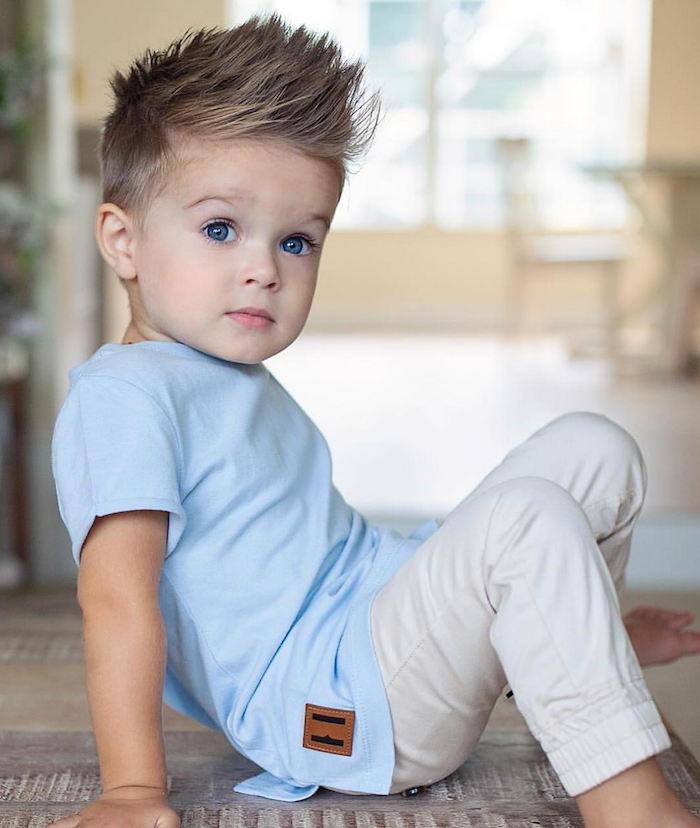 little boy, with blonde hair, blue eyes, blue shirt, white pants, guy hairstyles