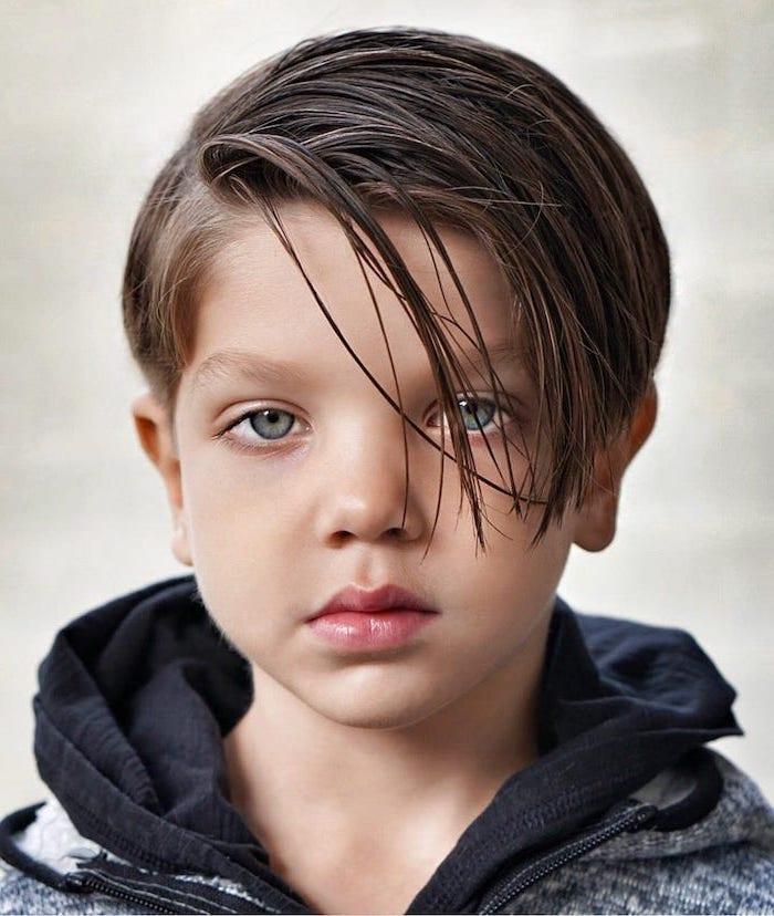 black-sweatshirt, side swept, brown hair, blue eyes, guy hairstyles, white background