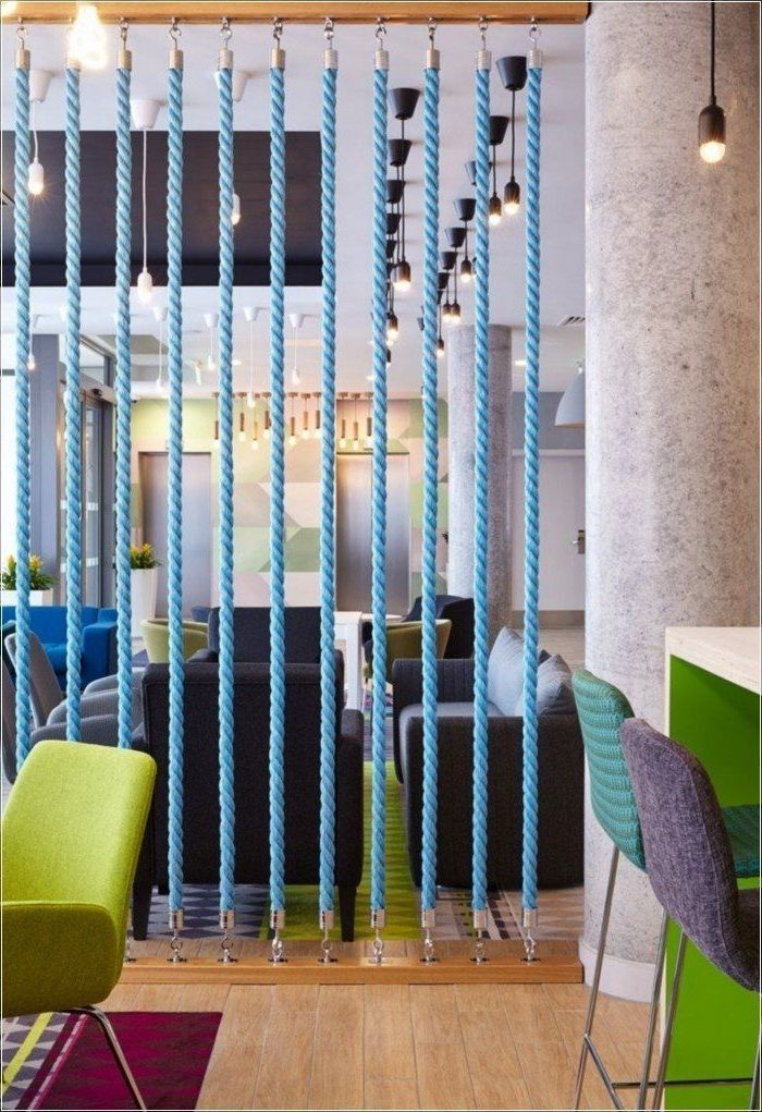 blue ropes, green armchair, wooden floor, sliding room dividers, grey and blue bar stools, grey sofas