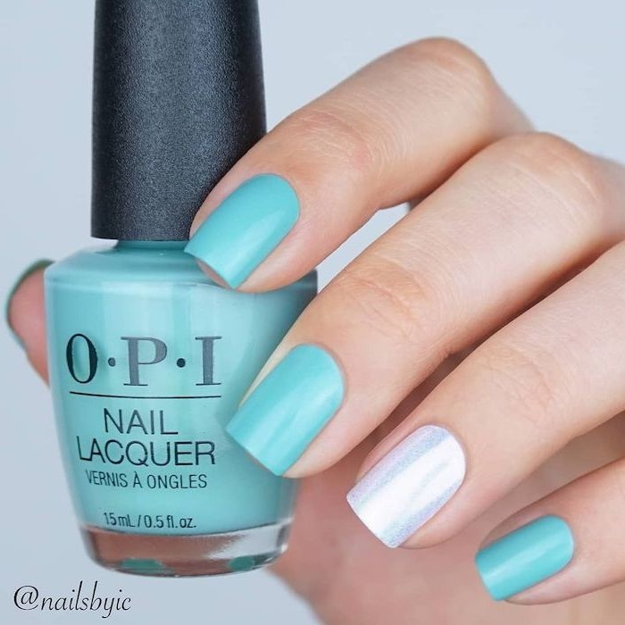 blue nail polish, silver glitter, white background, nail polish bottle, cute summer nails