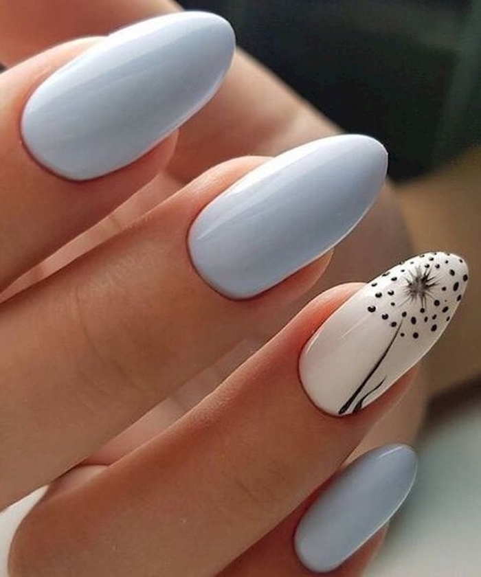 light blue nail polish, black dandelion seeds, almond nails, cute summer nails