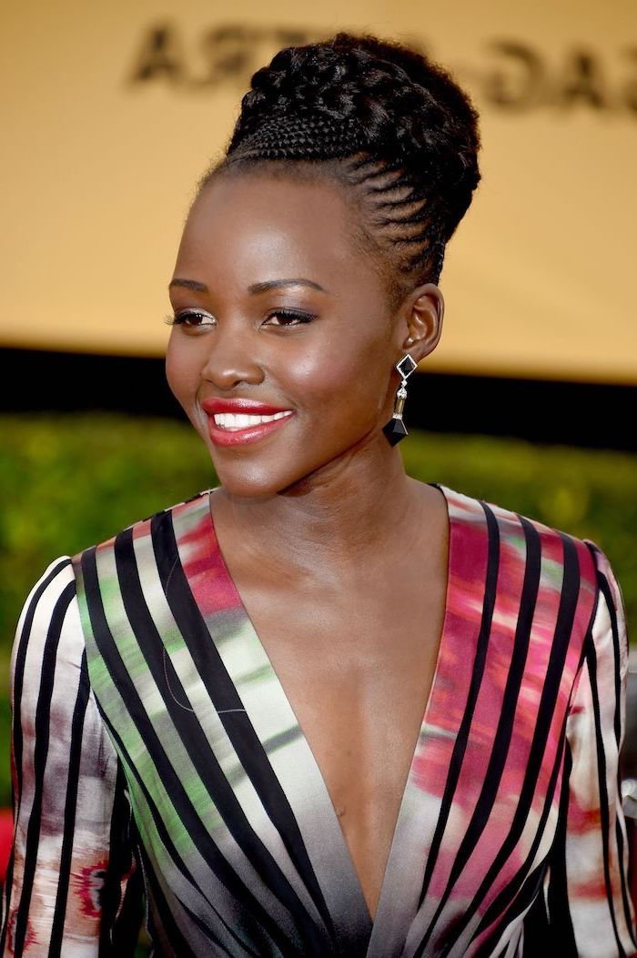 black braided hairstyles, colourful striped dress, lupita n'yongo, braided high bun, v neckline