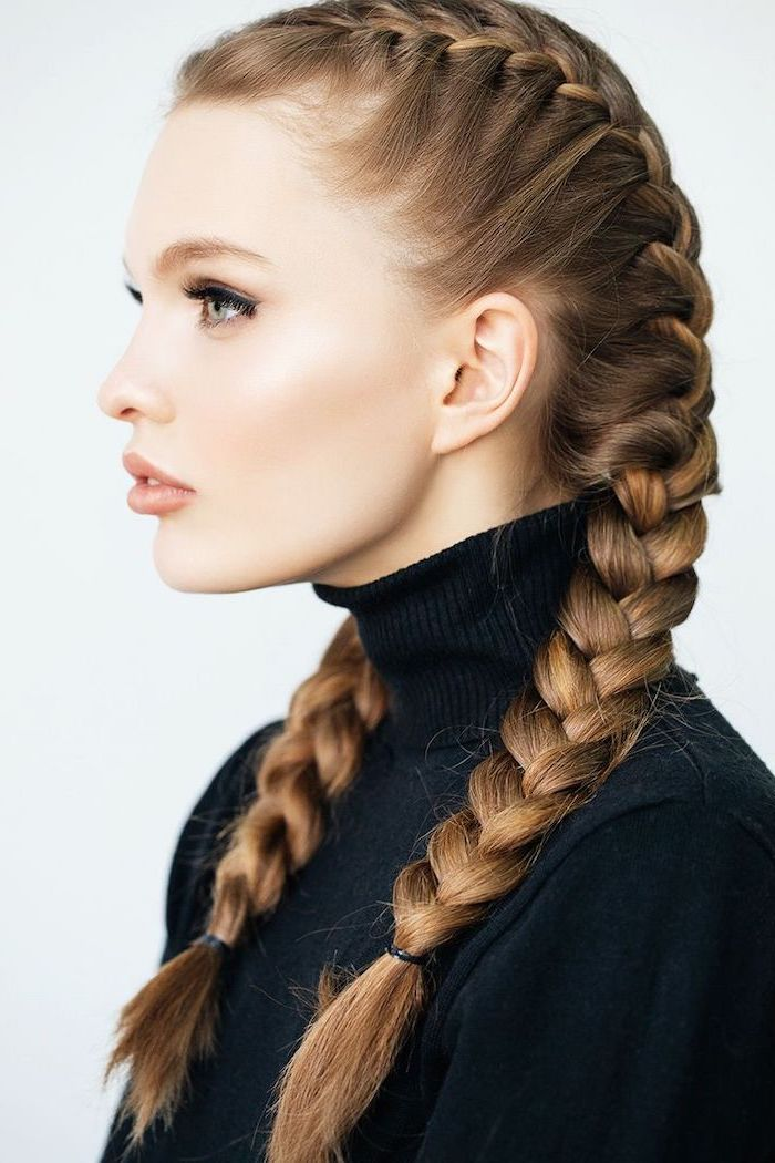 blonde hair, in two side braids, black braided hairstyles, black polo sweater, white background