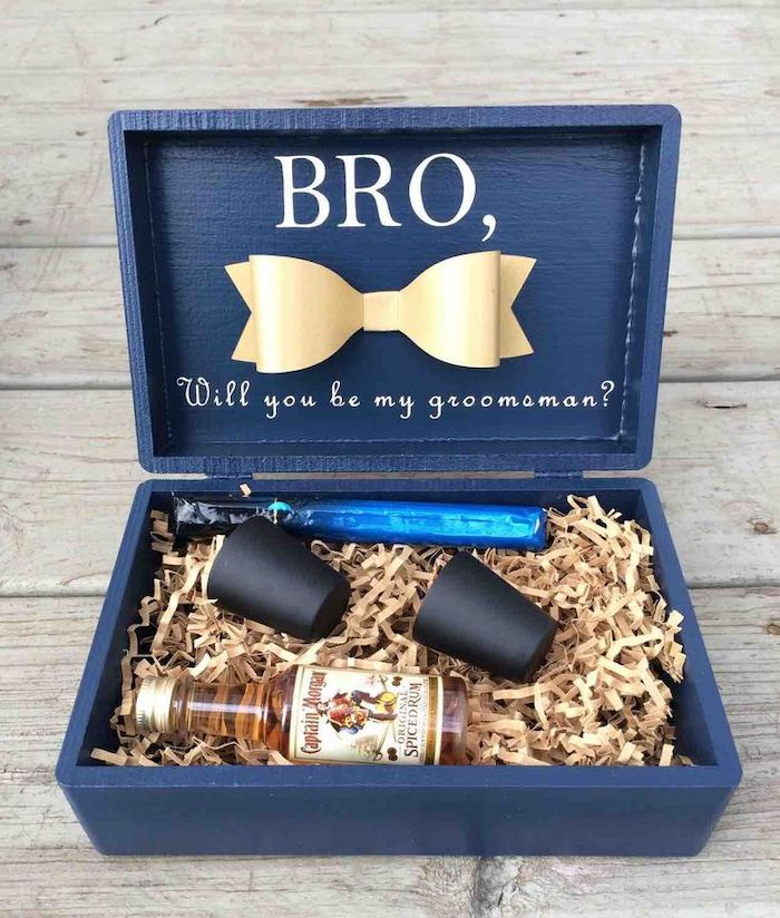 blue wooden box, groomsmen gift ideas, small rum bottle, two metal shot glasses, cigar wrapped in foil