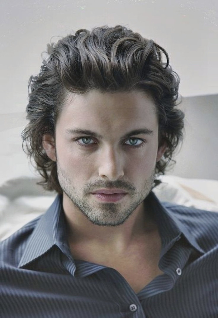 black curly hair, medium length, hairstyles for men, blue shirt, blue eyes