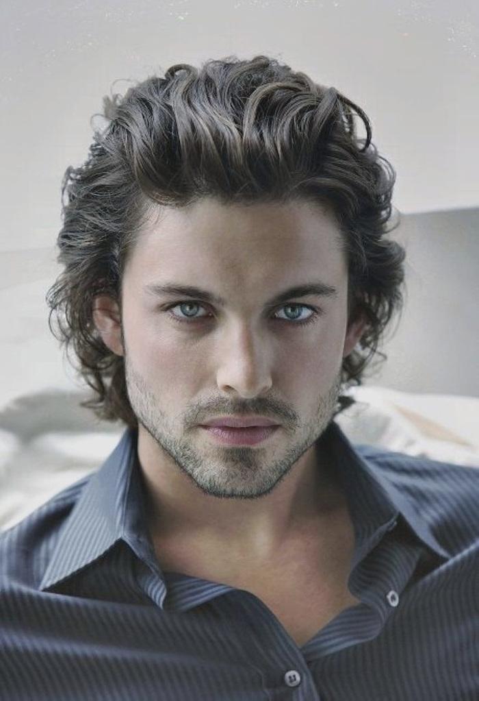 black curly hair, medium length, hairstyles for men, blue shirt, blue eyes