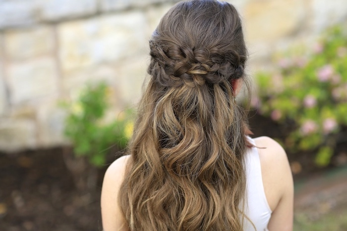 braided hairstyles for short hair, brown hair, two braids, loose waves, blurred background