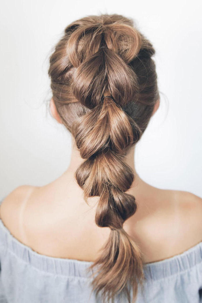 blue off the shoulder top, braided ponytail, how to braid hair, white background