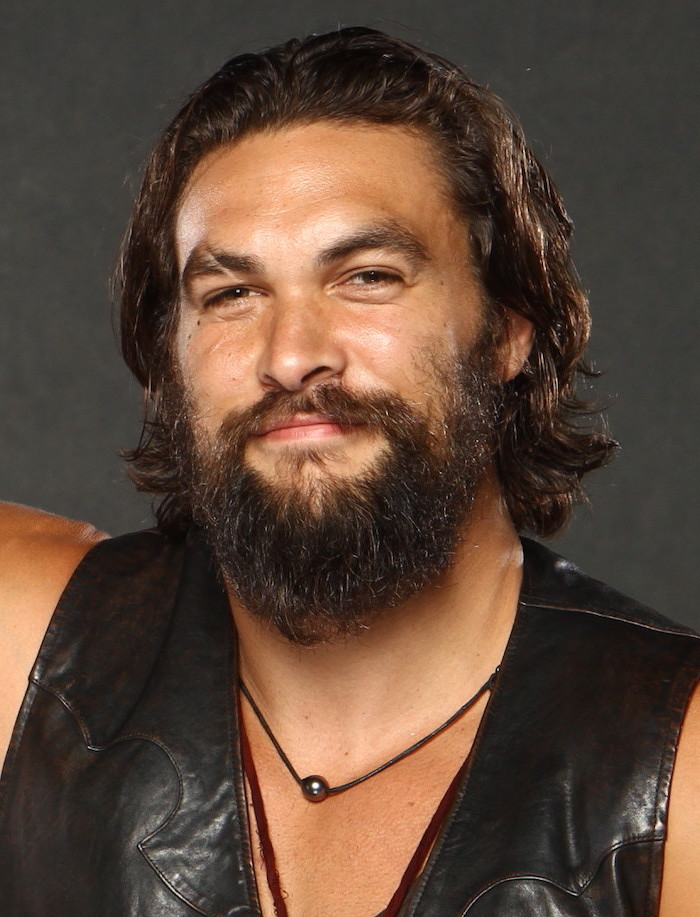 jason momoa, black leather vest, brown curly hair and beard, hair styles for men
