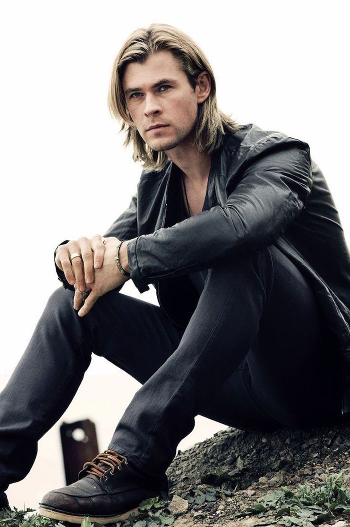 chris hemsworth, sitting on the ground, medium haircuts for men, black leather jacket, blonde hair