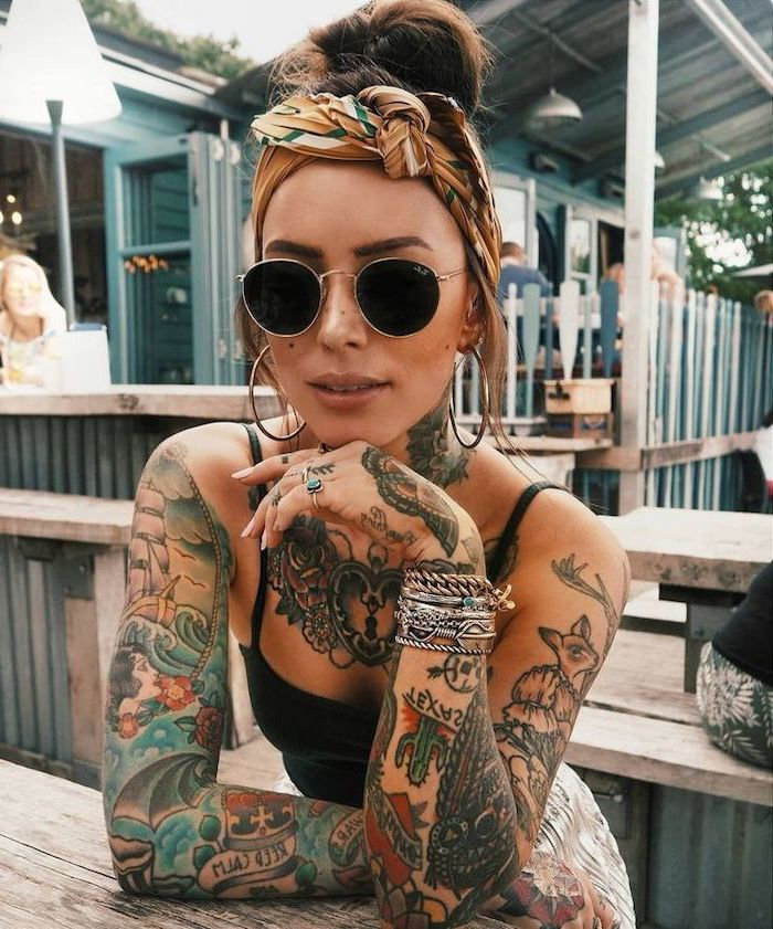 woman with sunglasses, coloured tattoos, on both hands, arm tattoo ideas, silver bracelets, chest tattoo
