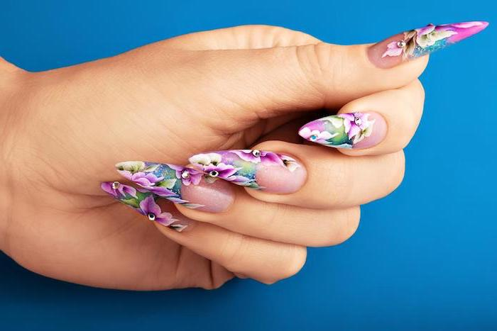 long stiletto nails, spring nail designs, blue background, floral motifs, pink flowers