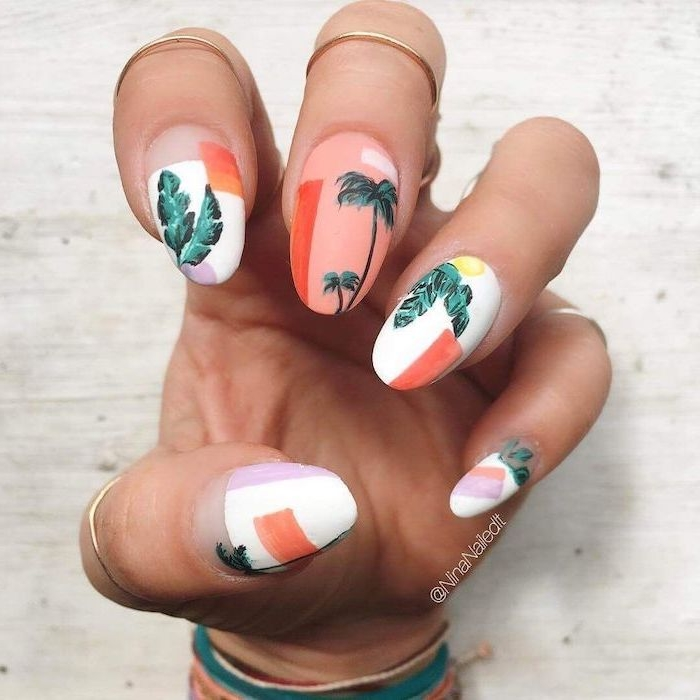manicure ideas, orange and white nail polish, green palm trees, gold rings, white background