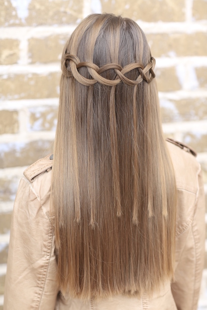 knotted braid, dark blonde hair, how to braid your own hair, brick wall, brown leather jacket