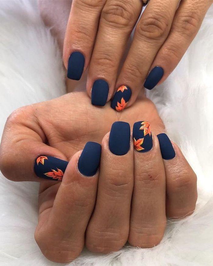 dark blue matte, nail polish, orange leaves, spring nail designs, short nails, white background