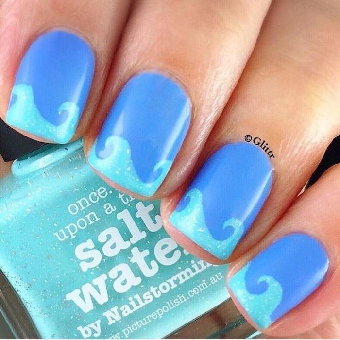 dark blue nail polish, light blue waves, manicure ideas, nail polish bottle