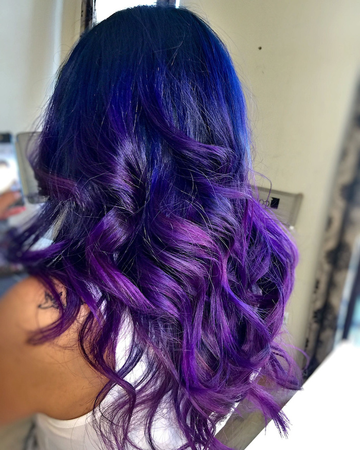 dark blue to violet, medium length, wavy hair, white top, blonde ombre hair