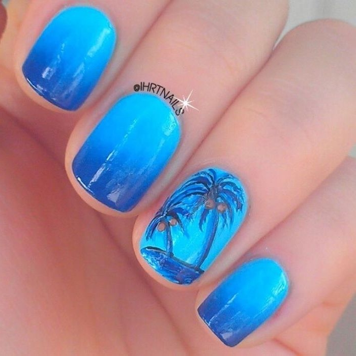 light and dark blue ombre, blue palm trees, manicure ideas, short nails
