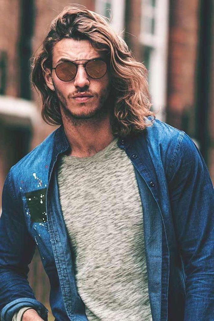 trendy haircuts for men, dark blonde, curly hair, grey t shirt, denim shirt