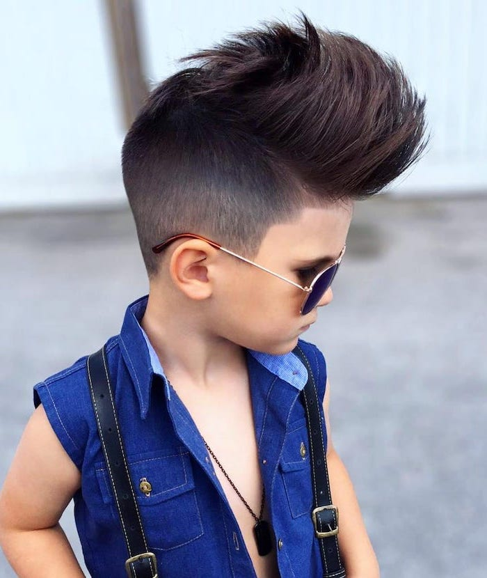 black hair, large mohawk, denim vest, dark sunglasses, black suspenders, teen boy haircuts, little boy
