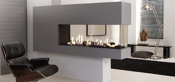 electric fireplace, black leather armchair, room divider screen, white floor, black carpet