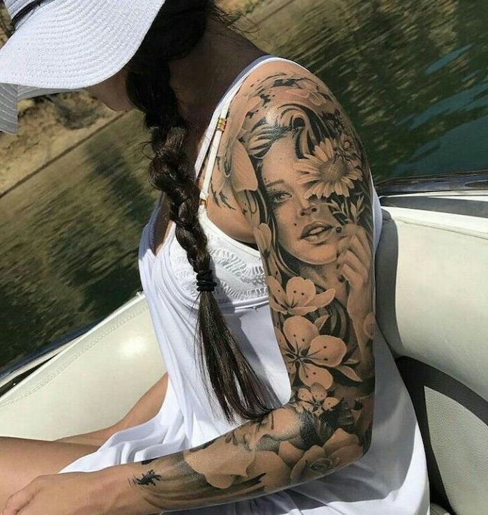 tattoo sleeve ideas for men, female face, surrounded by flowers, black braided hair, white dress