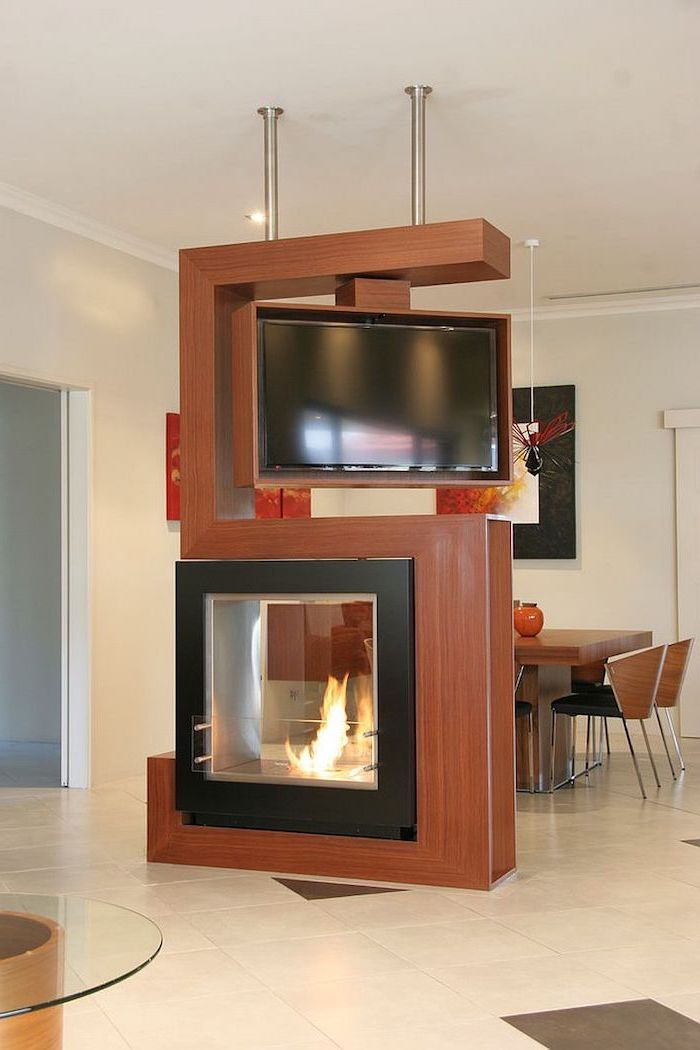 electric fireplace, rotating tv, wooden room dividers, tiled floor, wooden chairs, dining table