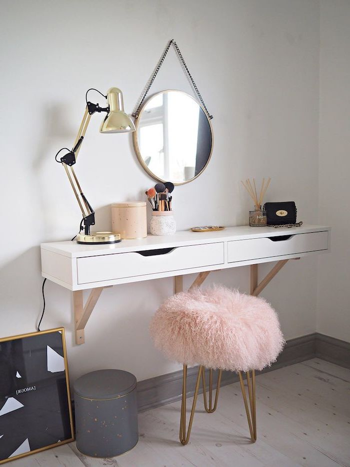 floating shelf with drawers, makeup vanity, metal stool, pink furry cover, wooden floor, white wall