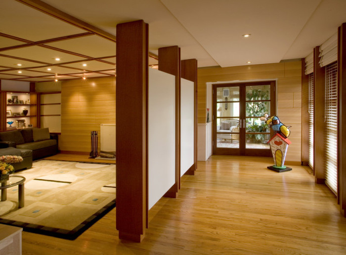 white panels, wooden blocks, large carpet, wooden room dividers, wooden floor and walls