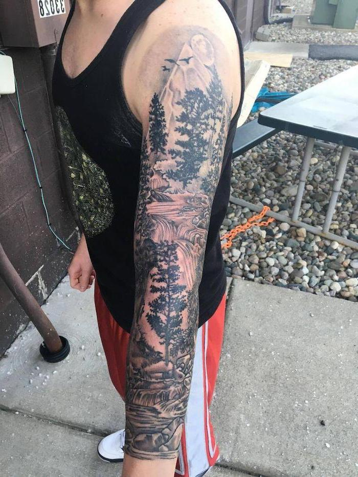 forest landscape, with a waterfall, best half sleeve tattoos, black top, red pants, white sneakers