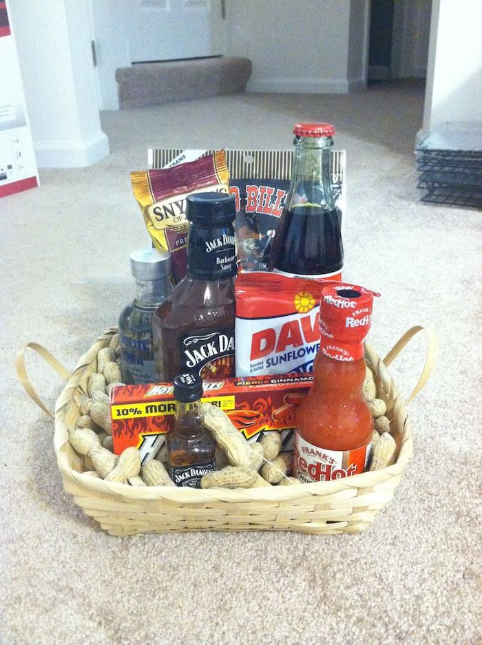 wooden basket, filled with nuts, cool groomsmen gifts, alchohol and soda, different snacks