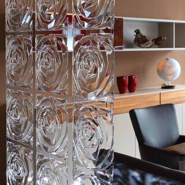square glass blocks, in the shape of a rose, room divider screen, black leather chairs, wooden shelves