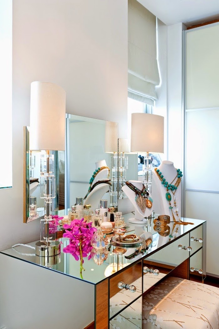 mirrored table, with drawers, three fold mirror, dressing table mirror, white walls, necklaces on mannequins