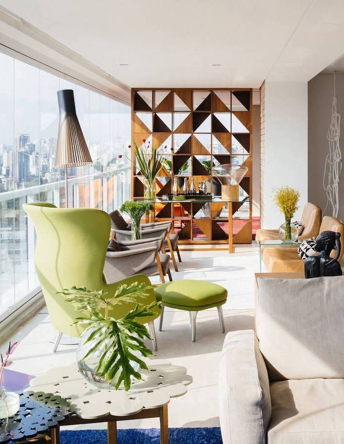 wooden triangles, arrange together, hanging room dividers, green armchair and ottoman, tall windows