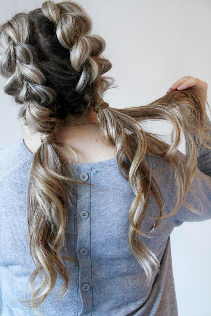 french braid hairstyles, grey cardigan, brown hair, blonde highlights, two braids, two ponytails