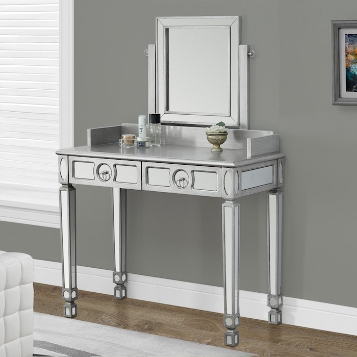 silver metal table, with drawers, square mirror, wooden floor, makeup desk vanity, grey wall