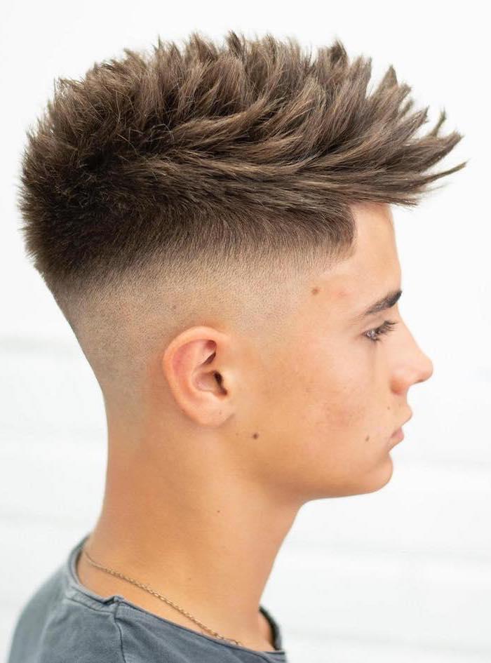 brown hair, long top, young men haircuts, grey shirt, white background