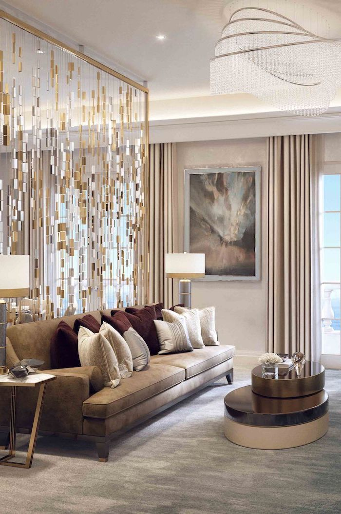 hanging chandelier, metal pieces, arranged together, hanging room dividers, grey sofa, grey carpet
