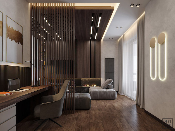 wooden poles, room divider screen, wooden floor, grey armchair, grey sofa, white walls, wooden accent wall