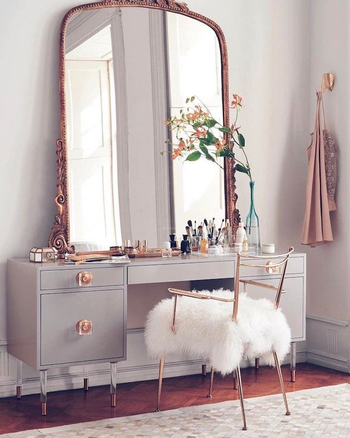 vintage mirror, gold metal chair, white furry cushion, grey drawers, mirrored vanity table