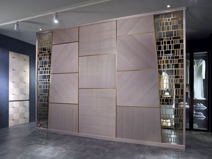 room partitions, grey blocks, brass metal, geometrical shapes, tiled floor, room partitions