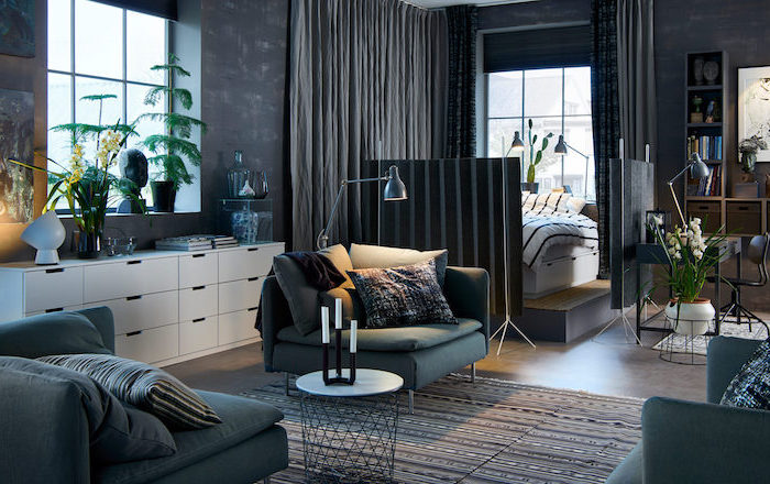 grey curtains, black folding, room partitions, dark blue armchairs, throw pillows, printed carpet